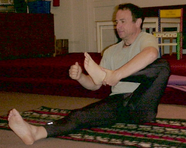 Robb teaching <i>leg cradles</i>